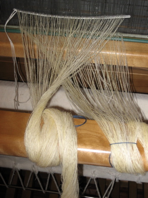 half the warp on the loom