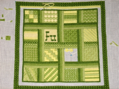 green and yellow squares of needlepoint sampler