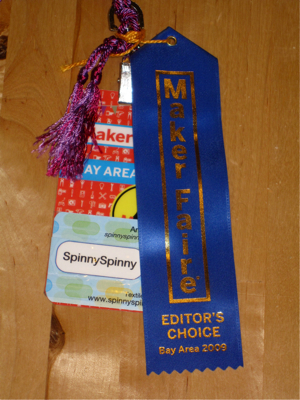 Maker Faire badge and Editor's Choice ribbon