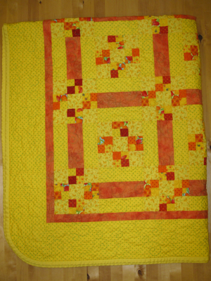 Yellow and orange quilt