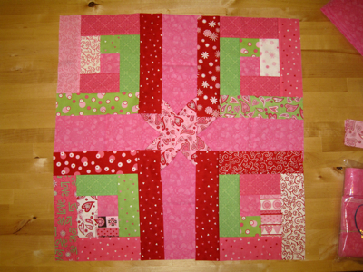 pink log cabin and stars quilt blocks