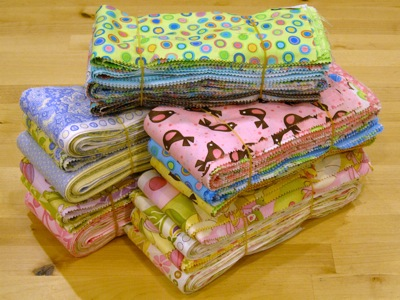 bundles of multicolor strips of fabrics